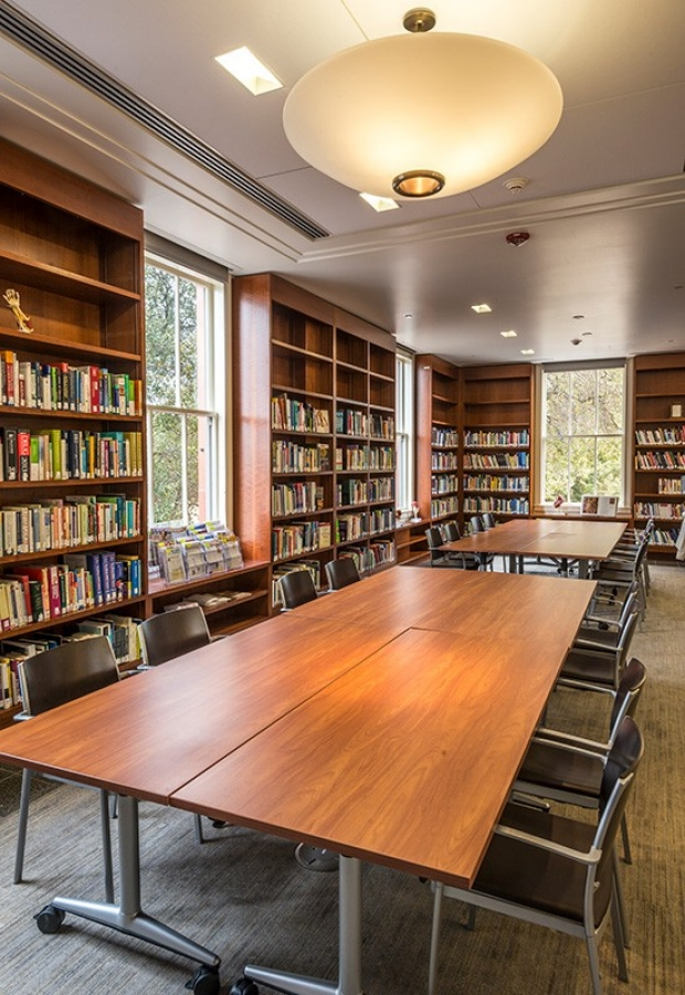 Interior of the library, with tables, chairs, and books