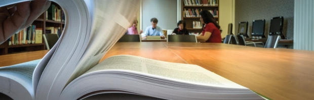 Close-up of large book on a long table